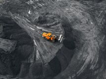 Free Yellow Excavator Loads Coal Into Crusher. Open Pit Mine, Extractive Industry, Top View Aerial Drone Stock Image - 196293381