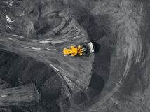 Free Yellow Excavator Loads Coal Open Pit Mine, Extractive Industry, Top View Aerial Stock Photo - 196820440