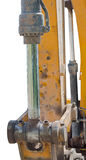 Yellow excavator machines. Part of modern yellow excavator machines isolated on white Stock Images