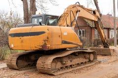 Yellow excavator for road repairing stock image