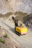Yellow excavator stonecutter Stock Photography