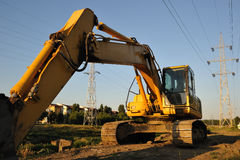 Yellow excavator at work in town Royalty Free Stock Photo