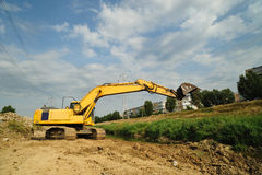 Yellow Excavator working in the district town Royalty Free Stock Photos