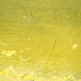 Yellow exposed concrete wall Stock Images