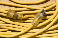Yellow extension cord. Stock Images