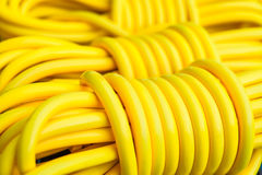 Yellow extension cord. Close up yellow electric extension cord Stock Photo