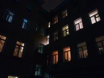 Yellow eyes comfort. Windows of an apartament house Stock Image