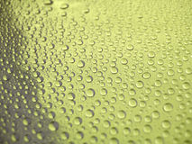 yellow för bakgrundsdroppvatten Arkivfoto