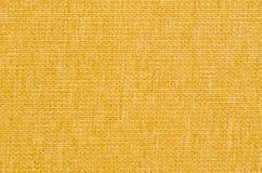 yellow för bakgrundstygtextur Arkivfoto