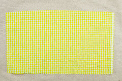 Yellow fabric. Sample of yellow checked gingham fabric as a background Stock Images