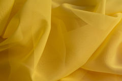 Yellow fabric, backdrop Stock Images