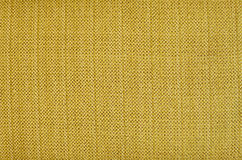Yellow fabric background Stock Images