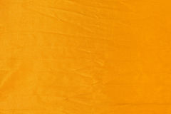 Yellow fabric background Stock Image