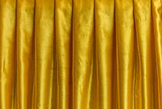 Yellow fabric curtain. The curtain made from textile Stock Photo