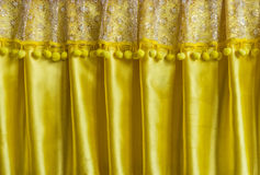 Yellow fabric curtain. The curtain made from textile with tufts Stock Photo