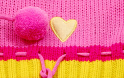 Yellow fabric heart. Children's cloth with details from yellow heart Stock Photography