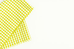 Yellow fabric, kitchen towel with checkered pattern, isolated on Stock Photography