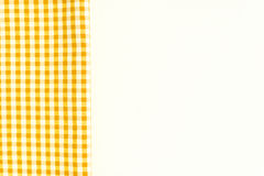 Yellow fabric, kitchen towel with checkered pattern, isolated on Royalty Free Stock Images