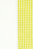 Yellow fabric, kitchen towel with checkered pattern, isolated on Royalty Free Stock Image