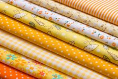 Yellow fabric for patchwork Stock Photos