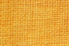 Yellow fabric pattern. Pattern of yellow fabric with a loose weave Stock Photo
