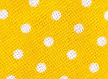 Yellow fabric texture with white polka dots Stock Photos