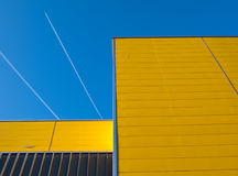 Yellow facade. Yellow and gray facade of a building in the Netherlands Royalty Free Stock Images