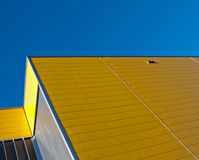Yellow facade. Yellow and gray facade of a building in the Netherlands Royalty Free Stock Photo