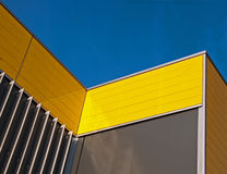 Yellow facade. Yellow and gray facade of a building in the Netherlands Royalty Free Stock Photography