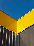 Yellow facade. Yellow and gray facade of a building in the Netherlands Stock Photo