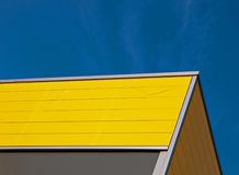 Yellow facade. Yellow and gray facade of a building in the Netherlands Royalty Free Stock Image