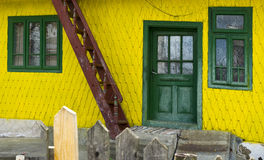 Yellow facade with green door and windows Romania Stock Photo