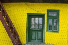 Yellow facade with green door and windows Romania Stock Photos