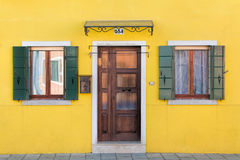 Yellow Facade of home with door and windows in Burano Royalty Free Stock Photos