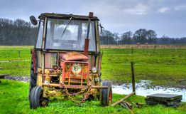 Yellow Farm Equipment on Green Grass Field stock image
