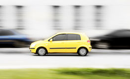 Yellow  fast car. Yellow fast car run on the road. Photography Royalty Free Stock Photos