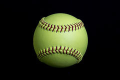 Yellow Fastpitch Softball. A fastpitch softball ball used in youth and high school games Royalty Free Stock Photo