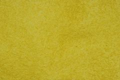 Yellow felt background. Royalty Free Stock Photos