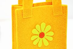 Yellow felt bag Stock Images