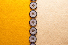 Yellow felt with buttons Stock Photography