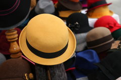 Yellow felt hat for sale in clothes store Stock Image