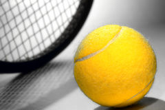 Yellow Felt Tennis Ball and Sport Racket Royalty Free Stock Photos