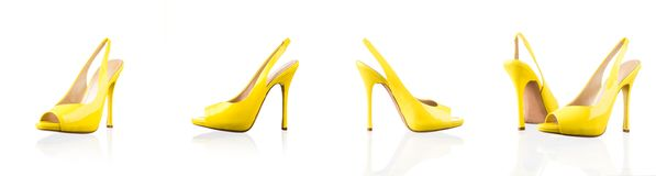 Yellow female shoes over white Royalty Free Stock Images