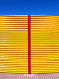 Yellow fence. Colored fence in the sun Stock Images