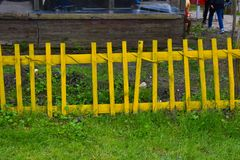 Yellow fence, on the grass stock photo