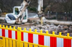 Road work fence excavator in city street Royalty Free Stock Images