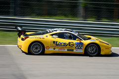 Yellow Ferrari 458 Challenge EVO in action. Lueg Sportivo team brings his  Ferrari 458 Challenge EVO on track at the Monza Circuit Royalty Free Stock Images