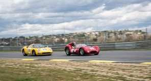 Circuit of Jarama, Madrid, Spain; April 03 2016: Ferrari 250 LM vs Maserati T60 Birdcage in a classic cars race royalty free stock photography