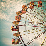 Yellow ferris wheel against a blue sky in vintage style Royalty Free Stock Images