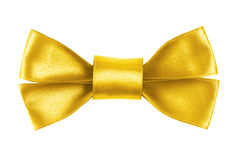 Yellow festive bow made from ribbon Stock Images